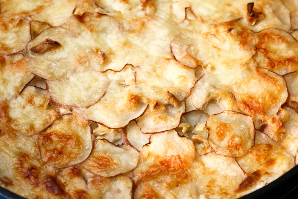 The Hungry Hounds— Potato & Garlic Goat Cheese Gratin