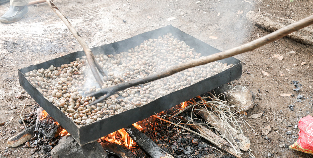 Cashew nuts, cleaned and beginning to roast -- Mombin Crochu, Haiti