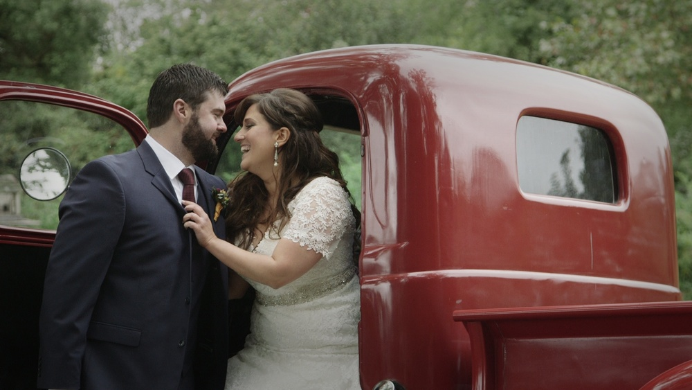 Monica and David; Married at the Crossed Keys Inn complete with a vintage red Dodge.