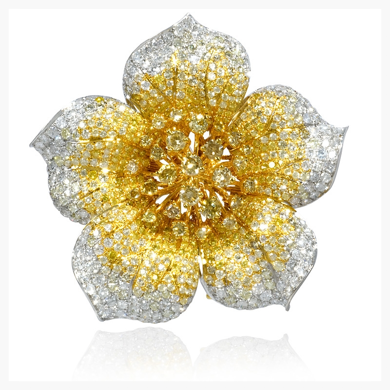 Diamond 18k two tone gold flower pin.    Jewelry Photography NYC Image © KKish 2015