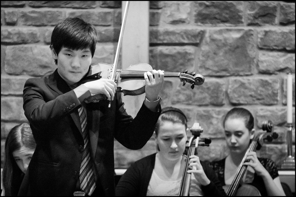 A CMC student playing the Mozart Violin Concerto No. 3, Movement I (Allegro); Fujifilm X-E1; Fujinon XF55-200mm @ 200mm; 1/125 sec @ f/4.8, ISO 6400; post processed with Adobe Lightroom 5.3 and Nik Software Silver Efex Pro 2