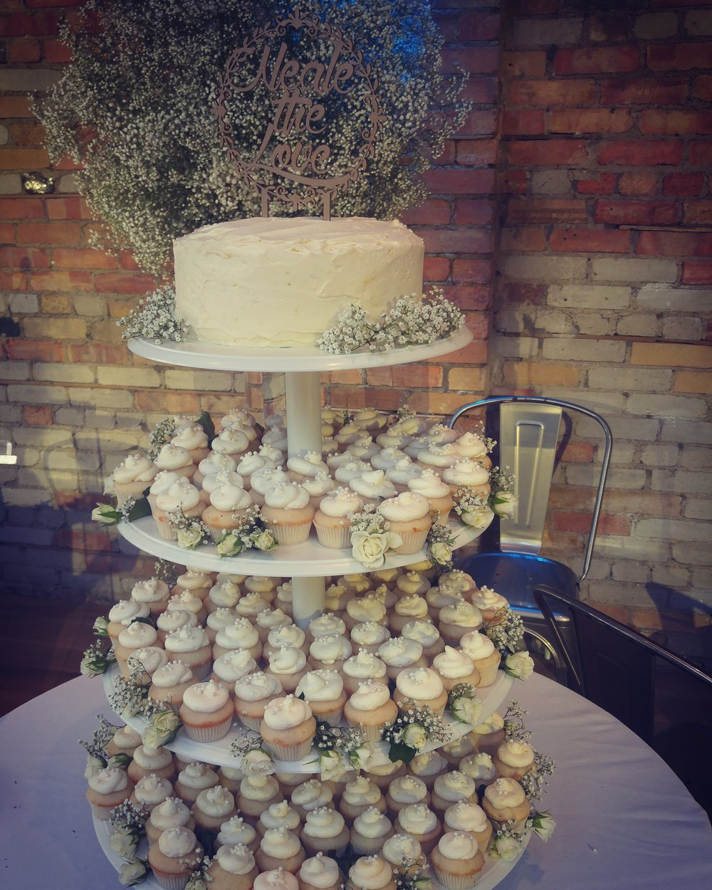 Rustic style wedding cake and baby cakes in vanilla with lemon buttercream
