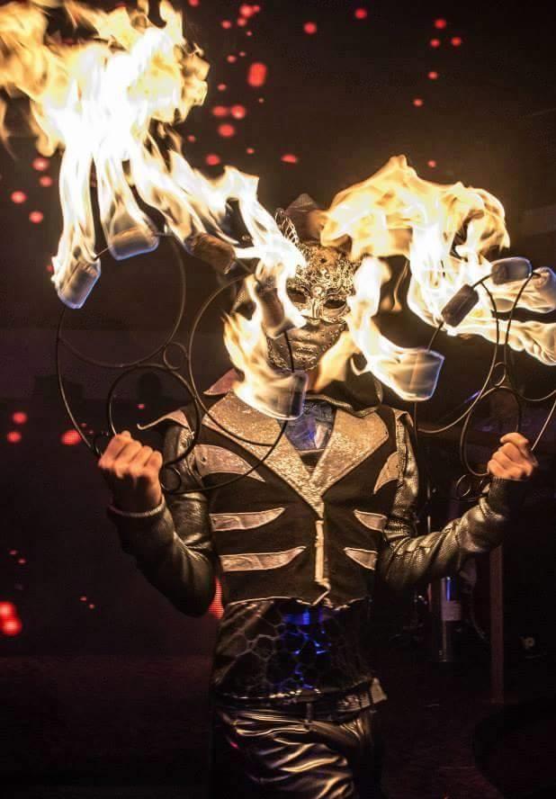 Venetian Masked Fire Performer