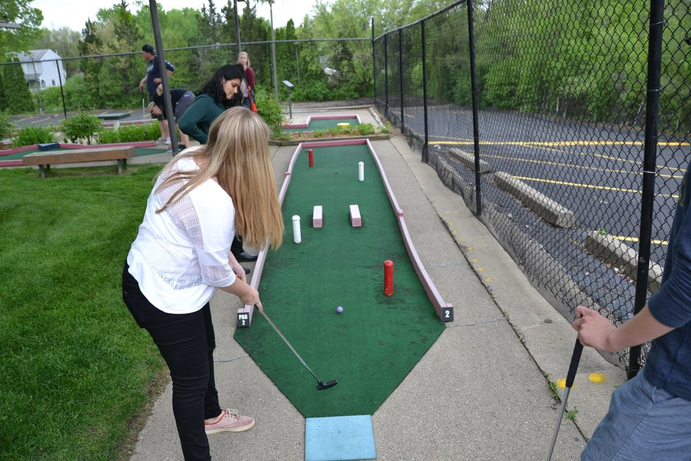 U of M and MSU labs celebrating the end of the semester with putt putt golf and a BBQ.