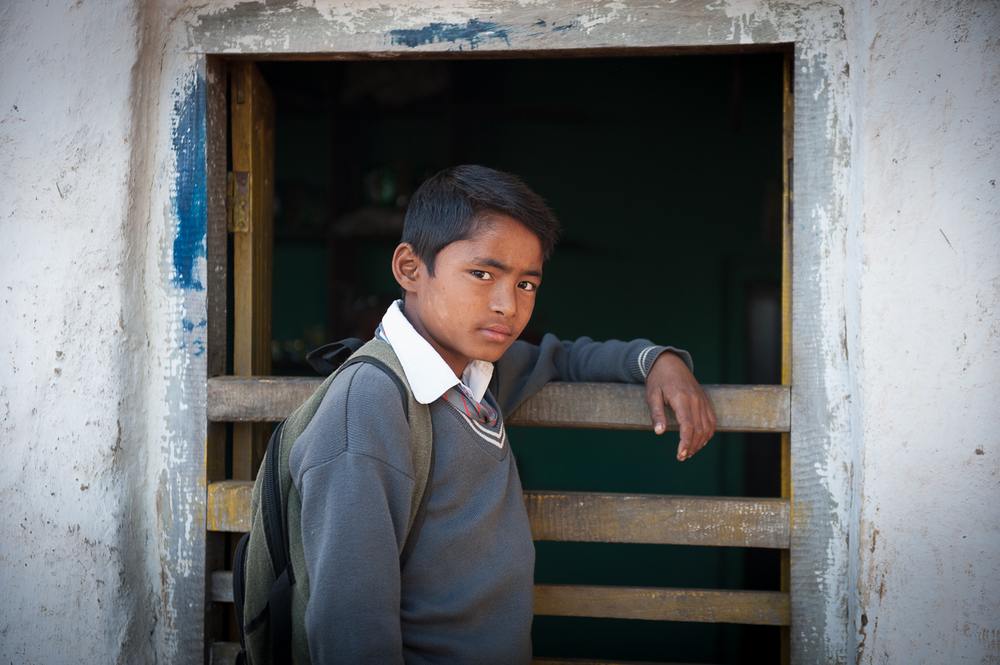 Just over half of the children in this community go to school regularly. The rest either don't attend at all or are pulled out for up to sixth months in order to go to Kathmandu to work in brick factories with their families.
