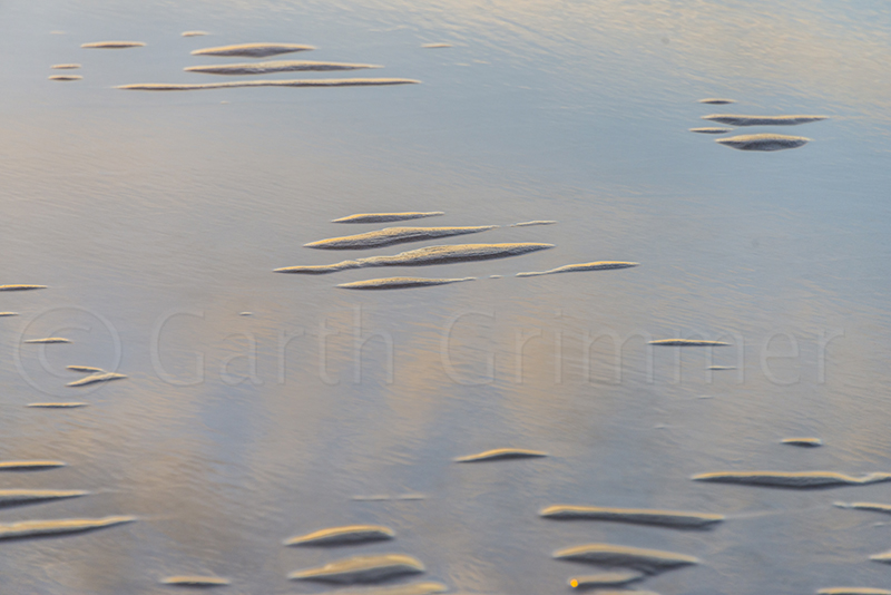 Evening low tide sky reflection