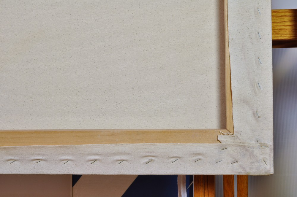 Treatment of water damaged canvas from Hurricane Sandy:  Disinfecting canvas, reduction of mold stains and replacement of rusty staples
