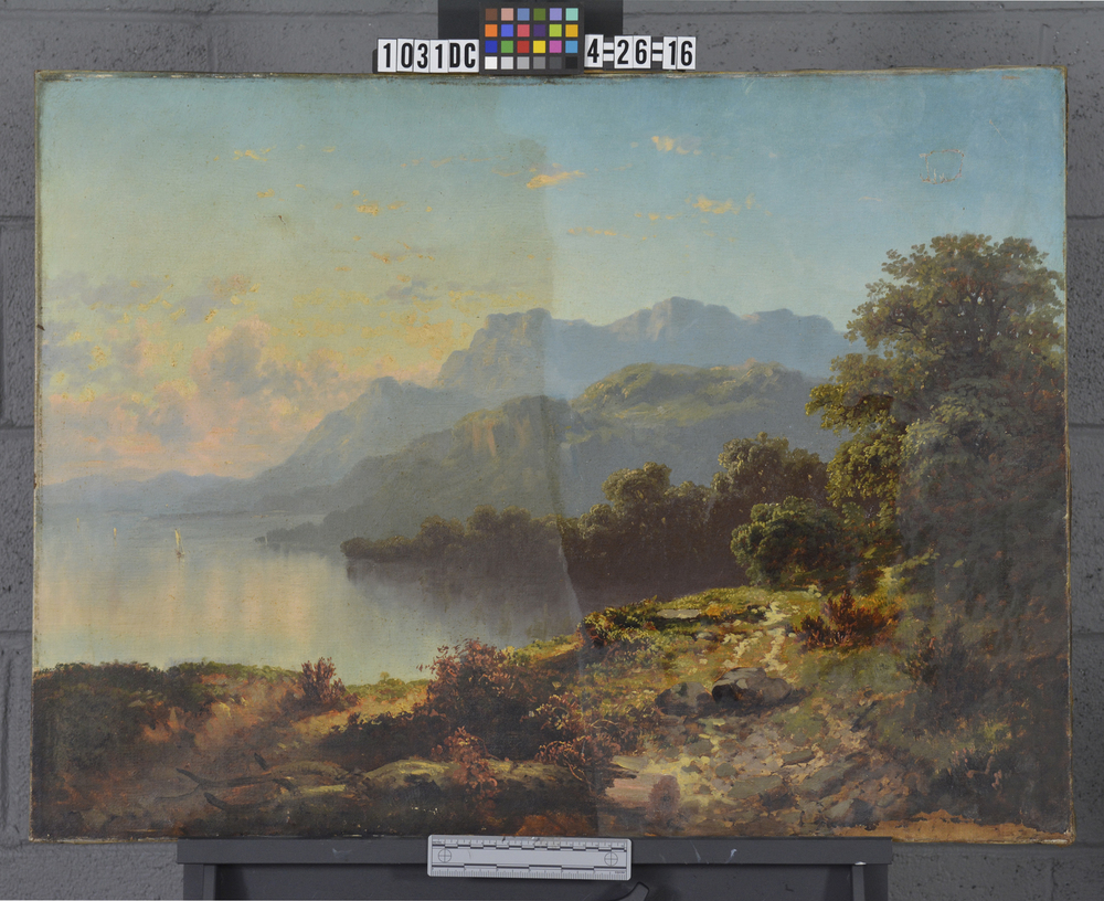 This is a photograph of the painting during cleaning.  The colors are slowly being revived and the contrast is once again established, providing the original illusion of depth and atmosphere.