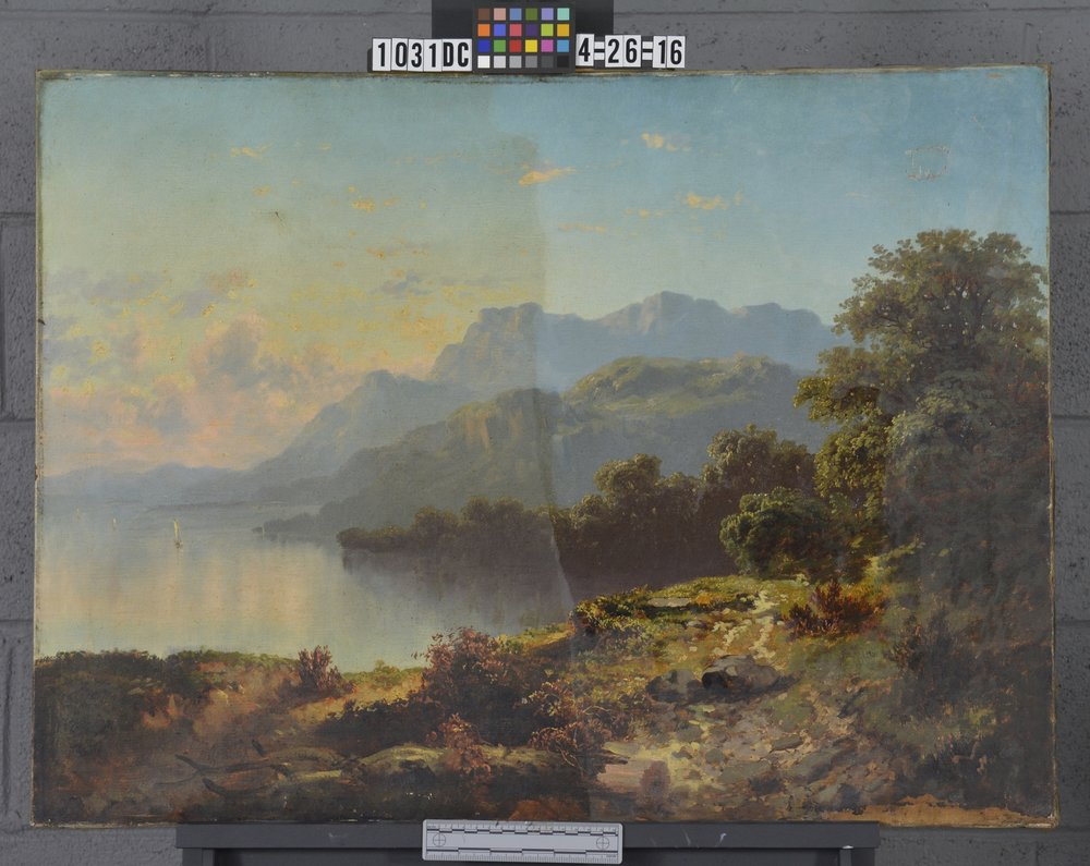 During cleaning photograph of a Hudson River Landscape.  Dirt and Varnish are removed to reveal original colors, contrast, and atmosphere.