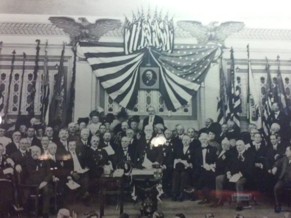 The photograph was taken during the 1910 dedication ceremony on opening day.  A portrait of Burchfield is visible top, center.  Image courtesy of Soldiers & Sailors Memorial Hall and Museum