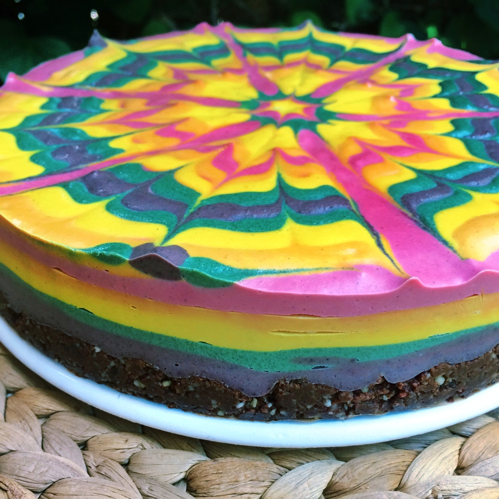Detail of Stephen's rainbow raw vegan cheesecake made of beet, turmeric, spirulina, and blueberry!