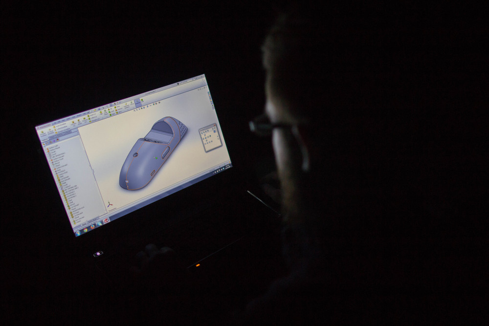 Designer Colin Beney creating a final 3-D model in Solidworks.