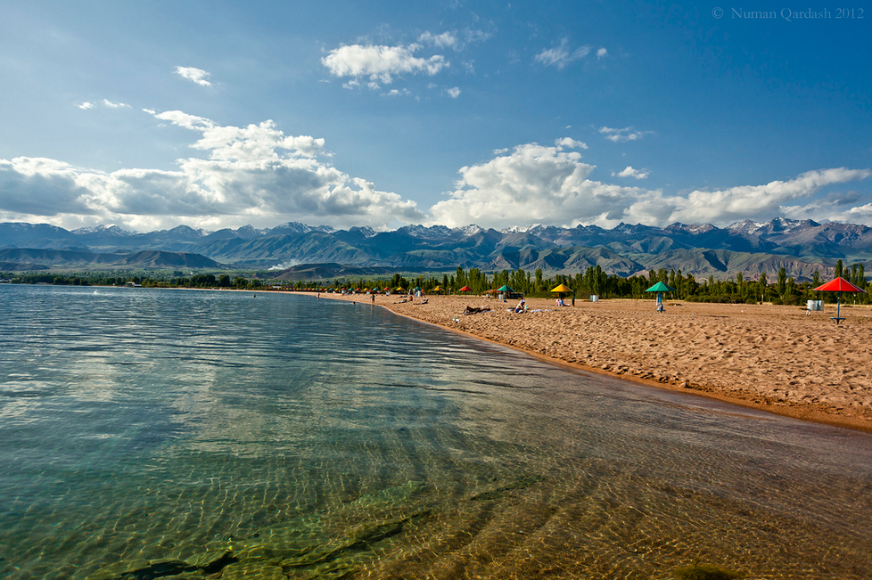 "Issyk-Kul means ""hot lake"". It is called this way because it does not freeze which is very rare for mountain lakes. Its altitude is  1,607 metres (5,272 ft), but its temperature gets to 23 °C  (73.4  °  F).    Photo by   Numan Qardash"