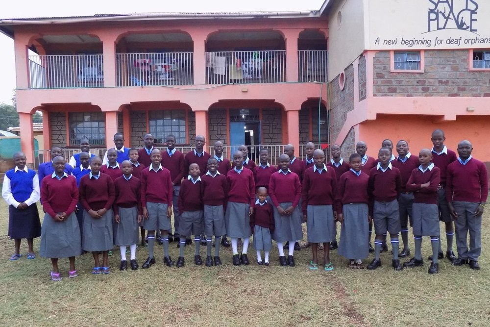 The children of Sam's Place modeling their new uniforms. Students in blue are the inaugural class of Sam's Place High School.