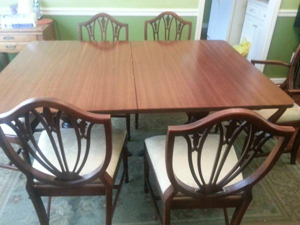 Dining Table and 6 chairs $170  - These shield back chairs are gorgeous. $170 for the table and the chairs is a great price, I think this set could be used as is or painted.  To see some examples of painted shield back chairs visit my  Pinterest page .