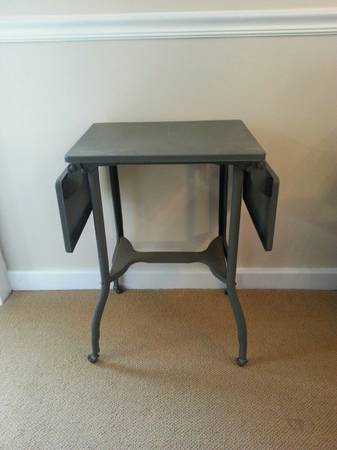 Metal Folding Side Table $20  - This is a great piece, I have a similar one in my living room in between 2 more formal antique chairs. Don't be afraid to mix styles in your house, thats what will make your room more unique.