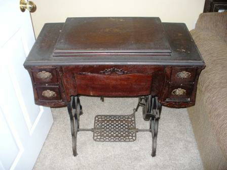 Antique Sewing Machine Table $65  - These tables make great side/accent tables.