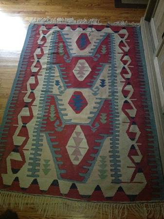 Antique 4' x 6' rug $250 - I love the design and colors on this rug, these would be a great piece to hang on the wall.