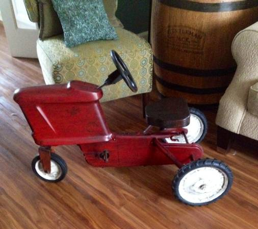 Antique Peddle Tractor $65  - Could be a really cute decor piece.