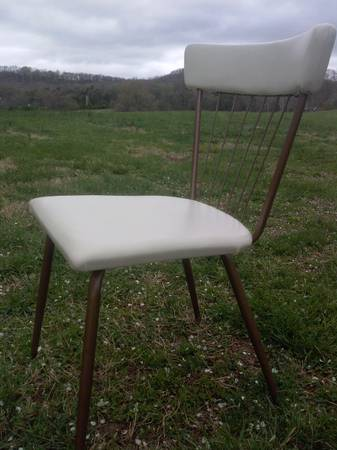White Retro Chair $35 - This chair could look good paired with a modern desk.