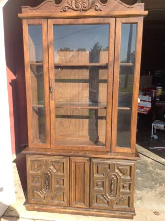 China Cabinet $100  - This might not catch your eye as is but would be a really attractive piece if it was painted.