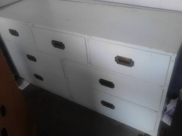 Campaign Style Dresser $50 - This is a good price, looks like it might need a bit of work but would look really nice once it was redone. Campaign style furniture is popping up everywhere, for some examples of similar pieces visit my Pinterest page.