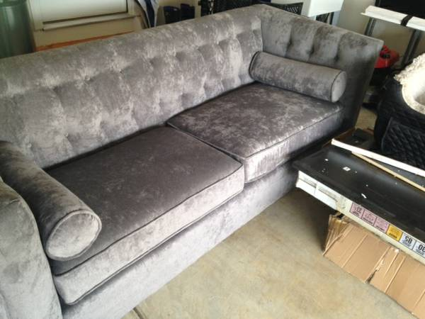 Grey Tufted Chesterfield Sofa $400  - Seller said that this sofa is brand new, they are selling because they couldn't fit it upstairs in their bonus room.