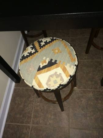 Set of Four Stools $50 - This is a good deal for all four and I like the fabric on them. Seller is also selling a bar height table that could be used with these stools for %75.