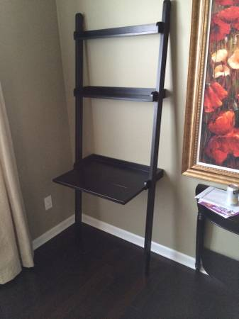 Pair of Crate and Barrel Leaning Shelves $60  - One is a standard 5 shelf and the other has this small desk/shelf.