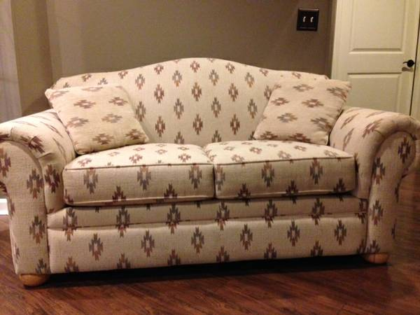 Loveseat $149  - I can't quite tell from the photos what colors this is, however I think it could have potential. If you got rid of the 2 accent pillows on it and put some new ones on it it could look really cute. Pattern reminds of a mix between an ikat and a tribal pattern.