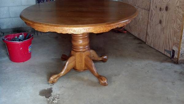 Pedestal Table with Leaf $50 - This is a good classic table and can work with many different styles of chairs.