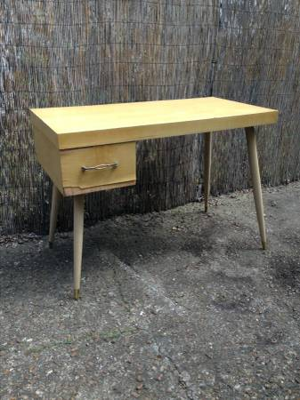 Mid Century Modern Desk     $40   This desk needs a bit of tlc but has a great vintage modern look and would be perfect in a small space.     View on Craigslist