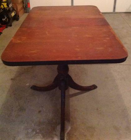 Antique Dining Table     $115   This pedestal dining table would look great painted and also comes with a leaf.     View on Craigslist