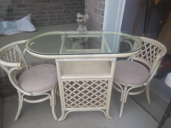 Rattan Table and Chair     $95   This is a cute little set and would look nice on a patio - I would change out the fabric and possibly paint the whole set.     View on Craigslist