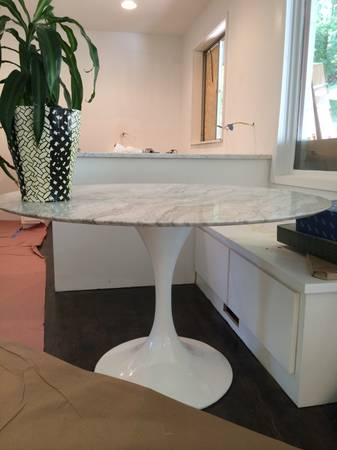 Marble Top Tulip Dining Table     $800   I love this Saarinen inspired table. This particular table  r  etails for $1600 , and is only 2 months old. Seller is getting rid of it because it doesn't work in their new house.     View on Craigslist