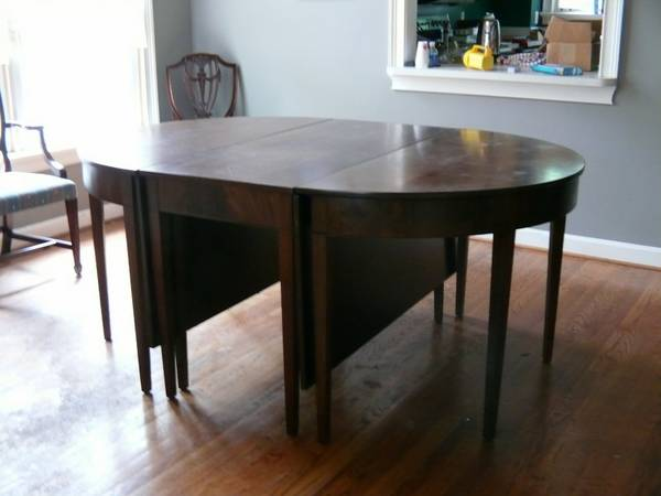 Dining Table with 2 Leaves     $200   This seller is also selling the chairs you see in the back of the photo -  6 for $200.      View on Craigslist