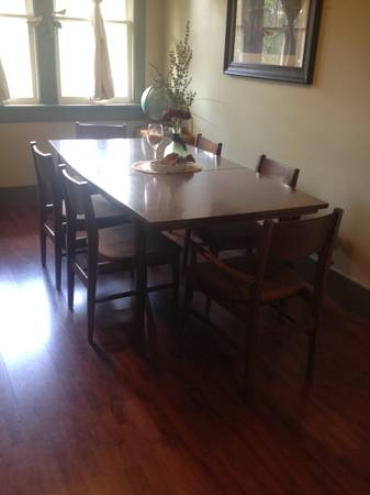 Mid Century Dining Set $200 This set comes with 6 chairs and 3 leaves. This is a great mid century set, probably just needs new seat fabric.  View on Craigslist