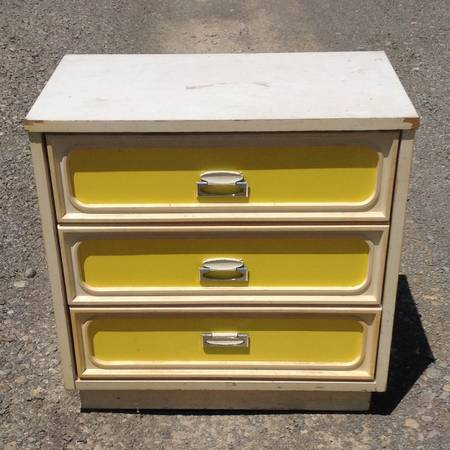 3 Drawer Dresser $25 This is a cute little dresser. It needs some putty and a coat of paint. I'd paint it white (maybe high gloss) but leave the yellow.  View on Craigslist