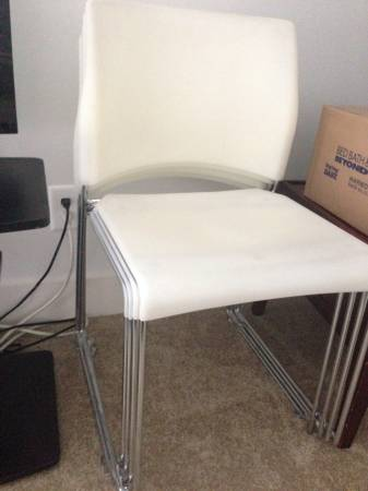 White Stacking Chairs     $15 each     View on Craigslist