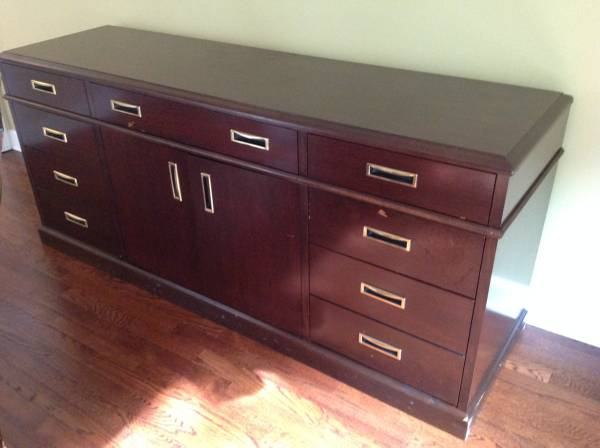 Credenza/Buffet $150 I really like the hardware on this, I would just give it a coat of paint. View on Craigslist