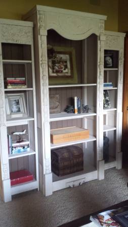 Custom Handcrafted Bookshelves $750 These bookshelves were custom made from salvaged antique doors and porch spindles. View on Craigslist