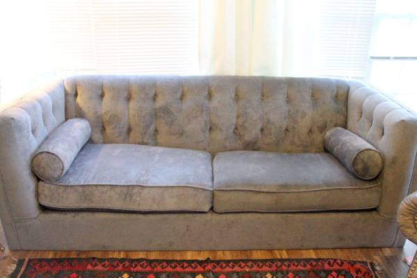 Gray Tufted Sofa     $550     View on Craigslist