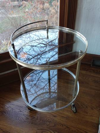 Vintage Glass Cart $150 This would be a perfect bar cart, tea cart or side table. View on Craigslist