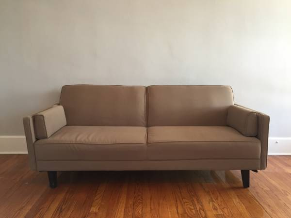 Modern Couch     $90   The back of this couch folds down.    View on Craigslist