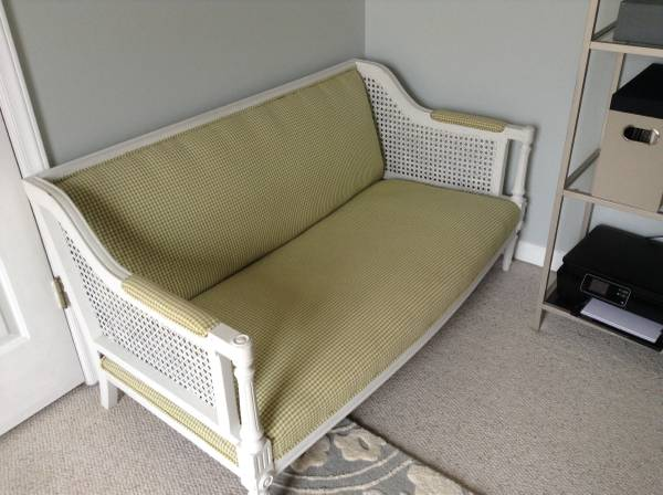 Settee with Cane Sides $90 I think this would be really cute with new fabric on it. View on Craigslist