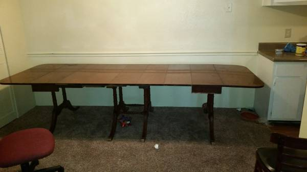 10ft Dining Table     $100   This dining table extends to 10ft with 7 leaves.    View on Craigslist