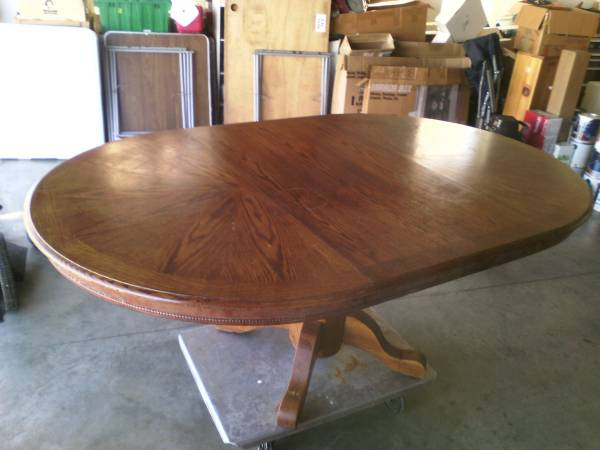 Oak Kitchen Table     $85   This is a very versatile table - you could use as is or paint it and pair it with any style chair.    View on Craigslist