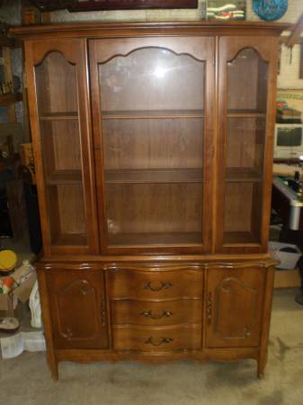 China Cabinet     $175   Another piece that would look great painted.     View on Craigslist