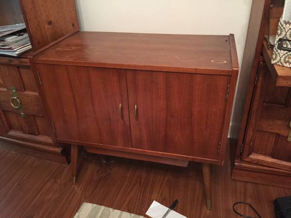 Mid Century Record Holder     $35   I think this piece would make a great side table or nightstands - it could even hold a small TV.    View on Craigslist