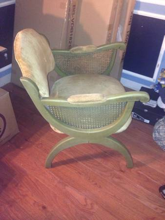 Vintage Cane Chair     $20   This is a great project piece - with new fabric and a coat of paint it would look fabulous.    View on Craigslist
